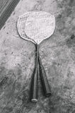 Children`s rackets. For playing badminton. Old, but not used rackets. Monochrome photo stock photos