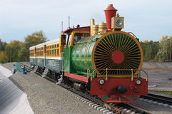 The children's railway. Small train for driving children around of park Royalty Free Stock Image