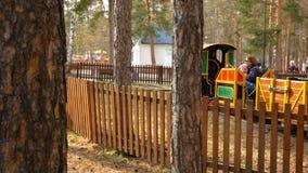Chelyabinsk, Chelyabinsk region / Russia - 04.25.2019:  Children`s train - attraction in the amusement park. stock footage