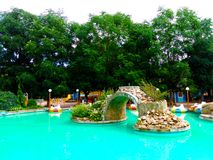 Children`s recreation area, turquoise pond in the park stock image