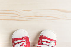 Children`s red sneakers. View from above. Royalty Free Stock Images