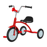 Children`s red tricycle with black seat and steering wheel, with rubber pneumatic hooters in front,. Isolated on white Stock Image