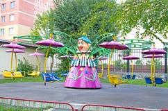 Children`s revolving carousel in the park. royalty free stock photo