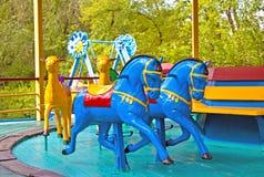 Children`s revolving carousel in the park. Horses, camels. stock photos