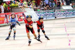 Children's roller skating game Royalty Free Stock Images
