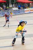 Children's roller skating game Royalty Free Stock Photo