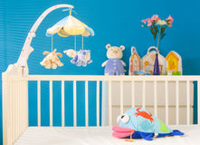 Children's Room. Crib and soft baby toys at children's room. Toys are officially property released Royalty Free Stock Photo