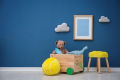 Children`s room with bright color wall. Interior details stock photo