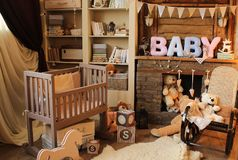 Children`s room with toys and a bed. fireplace, bookcase