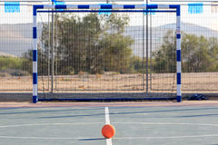 Children`s rubber soccer ball front of gates. On the court Royalty Free Stock Images