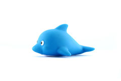 Children's rubber toy fish dolphin. Children's rubber toy a blue fish dolphin on a white background royalty free stock photos