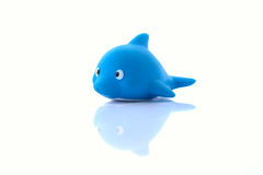 Children's rubber toy fish dolphin. Children's rubber toy a blue fish dolphin on a white background royalty free stock photo