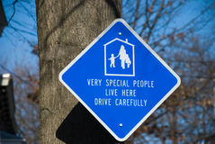 Children's Safety Sign. Blue diamond-shaped sign in a residential area urging careful driving Royalty Free Stock Image