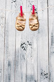 Children's sandals hanging on a clothesline. Stock Photo