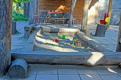 Children`s sandbox with toys, in a public park. Russia. royalty free stock image