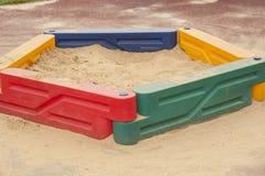 Children's sandbox with yellow sand Stock Photos