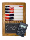 Children's school board, abacus and calculator. Children's school board and abacus made in the fifties last century and the modern calculator Stock Photos