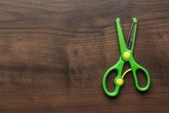 Children's scissors on the table Stock Photos