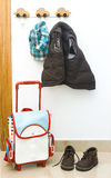 Children's set. In a children's room on hangers the jacket hangs there is a backpack and boots Stock Image