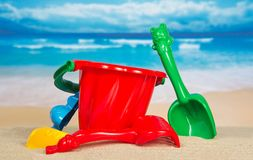 Children's set for game with sand. On the seashore Stock Photos