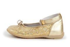 Children's shiny golden shoe for the girl Stock Images