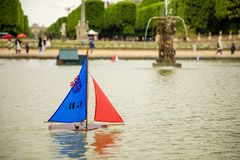 Children`s ships in fountain near Luxembourg Palace in the Luxembourg Garden in Paris, France. Children`s ships in fountain near Luxembourg Palace in the stock photo