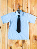 Children's shirt with short sleeves and tie Royalty Free Stock Photos
