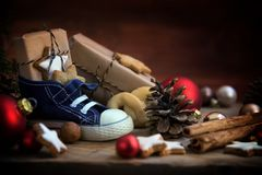 Children`s shoe with sweets and gifts for St. Nicholas Day on De Royalty Free Stock Photo