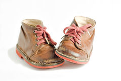 Children's shoes. Old Leather children's shoes on a white background Stock Photography