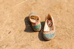 Children's shoes in dirt Royalty Free Stock Photo