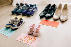Children`s shoes next to an adult Royalty Free Stock Photo