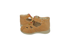 Children's shoes. A pair of brown children's shoes on a white background Royalty Free Stock Photos