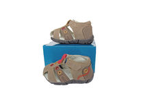 Children's shoes. Two children's Shoe with a box on a white background Royalty Free Stock Photo