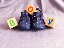 Children`s shoes and wooden cubes stock photography