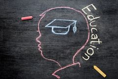 Children`s sketches aimed at success on a chalkboard with chalk. The concept of intelligence comes from education and back to school Stock Photography