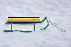 Children`s sled in the snow in winter. sledding. Childhood Stock Images