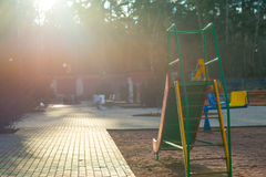 Children`s slide against the Sun. And background of wood Stock Photos