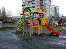 Children's slide in the park area of the city on a rainy day Stock Images