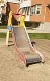 Children`s slide on a playground near the residential building Royalty Free Stock Photography