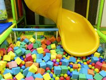 Children`s slide with a pool of colored stock image