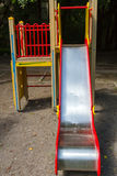 Children& x27;s slide on the street. Children& x27;s playground with a slide in the street Royalty Free Stock Photos