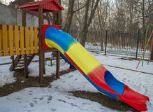 Children`s slides and playgrounds. In snow Stock Images