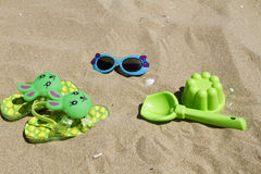 Children`s slippers beach Royalty Free Stock Images