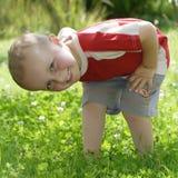 Children's smile. Little boy in summer clothing in rural garden Stock Image