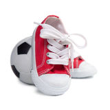 Children's sneakers and soccer ball Royalty Free Stock Image
