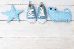 Children`s sneakers and toys blue. Mockup. Children`s sneakers and toys blue. Copy spacy royalty free stock photo