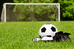 Children's soccer gear on field Stock Photography