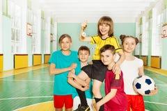 Children`s soccer team celebrating victory royalty free stock image