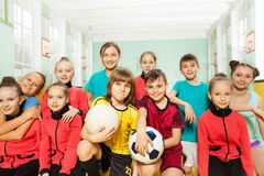 Children`s soccer team in school sports hall Royalty Free Stock Photo