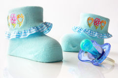 Children's socks and nipple Royalty Free Stock Images